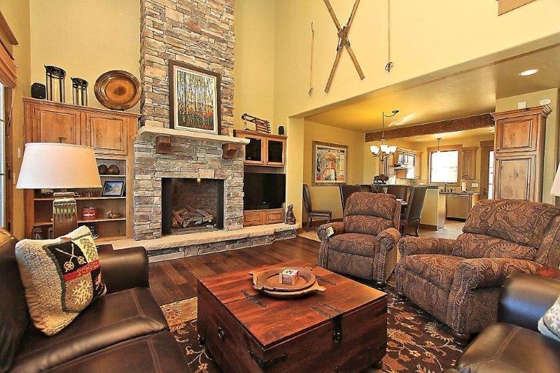 Cozy up next to the huge fireplace in the living area after a long and adventurous day - Mountain Terraces 721 - Fraser - rentals