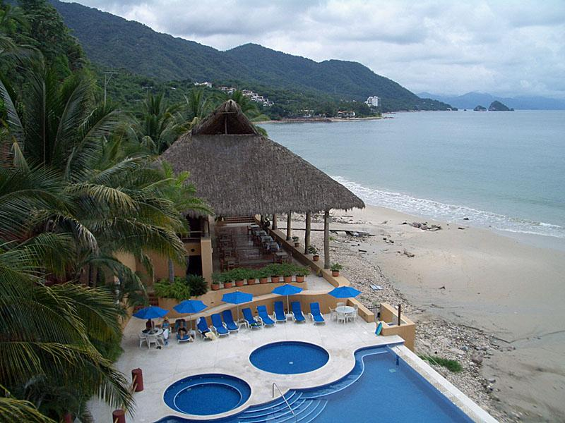 View to pool and restaurant - South Shore - Secluded Beachfront 3 BR Condo - Puerto Vallarta - rentals