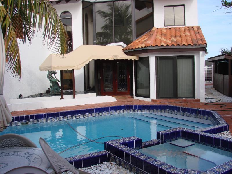 Townhome front, pool and hot tub - Elegant Melbourne Beachfront Vacation Home - Melbourne Beach - rentals