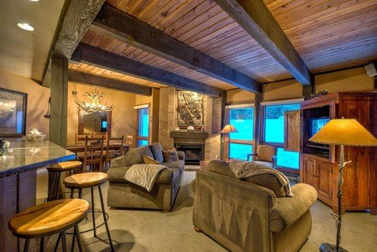 Large and Open Living and Dining Area, Leading to The Large Balcony, With Flat Screen TV, Gas Fireplace - Lodge B108 - Steamboat Springs - rentals