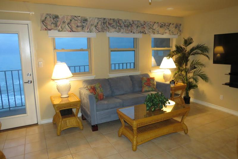 One of two couches in Living room with a 50 inch TV - Large 3 Bedroom Beachfront Condo - South Padre Island - rentals