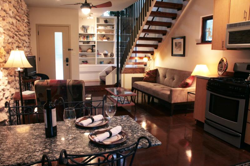 Living room facing front - couch makes into a double bed - COZY, MODERN TREEHOUSE ON 1/2 ACRE NEAR ZILKER - Austin - rentals