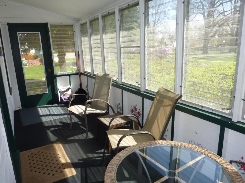 Screened porch on Cottage A, with vintage glass louvers that can be opened or closed. - 2 bedrooms, screen porch, walk to Lake Michigan - South Haven - rentals