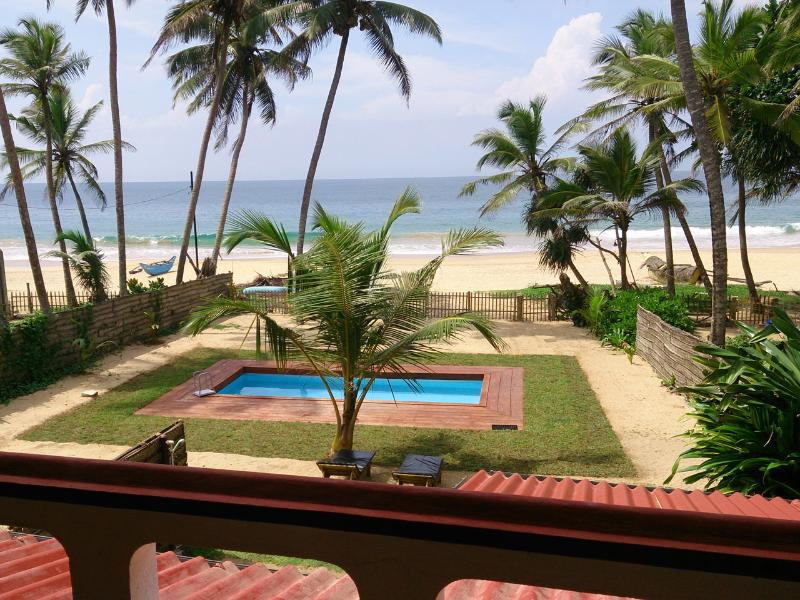 Beautiful Indian Ocean view from the upstairs balcony looking over the front garden, pool and beach - Tropical Beach House, Hikkaduwa - Hikkaduwa - rentals