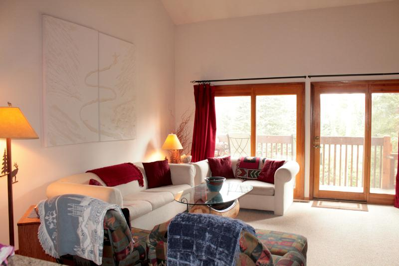 Our cozy living room offers views to the forested wetlands just outside. - 3 BR/2.5 BA Silverthorne Condo - Sleeps 8-10 - Silverthorne - rentals