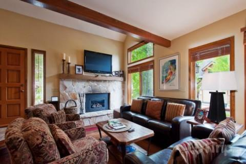 Beautiful living room also has a large stone fireplace with mantle, 42