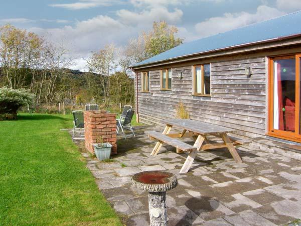 RHIEWGOG, log cabin with lovely views, hot tub, WiFi, pet-friendly, in St Harmon near Rhayadar, Ref 28551 - Image 1 - Rhayader - rentals
