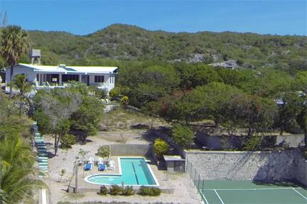From a friend's drone, a view from just over the beach - Beachfront villa with pool, tennis, superb view - Treasure Beach - rentals