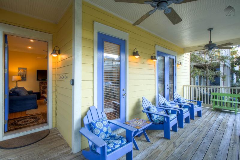 Enjoy gulf breezes at day's end from the adirondack chairs on the front porch of Five SeaSons - Gulf views, roof deck, community pool access on quiet street - The Five SeaSons - Seagrove Beach - rentals