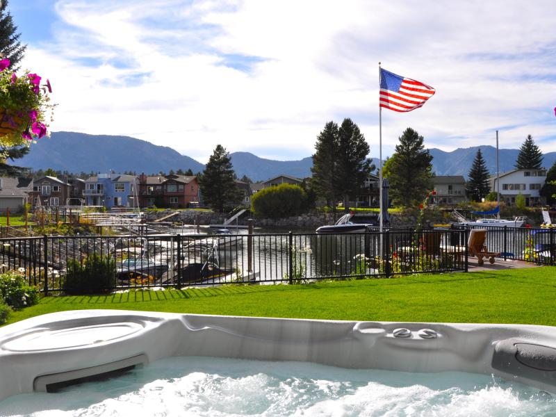 8-person massaging-jets hot tub with view of the western sky, mountains & waterway - Tahoe Keys Waterfront~huge spa, dock in backyard - South Lake Tahoe - rentals