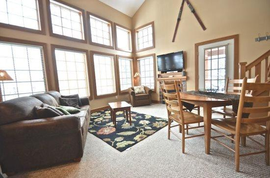 Spacious Livign Room with Queen Sofa Sleeper, Flat Screen TV, Fireplace, and Wall of Windows. - Updated 3BR Condo In Desirable Disciples Village Community, Sleeps 12 - Boyne Falls - rentals