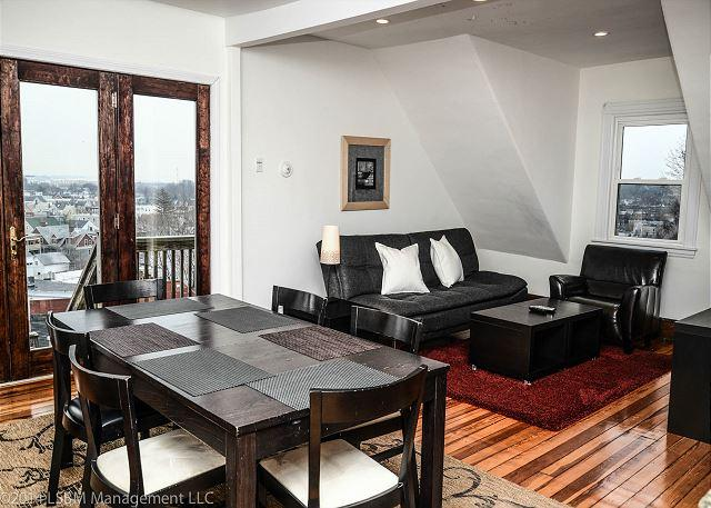 Quiet Urban Getaway in Boston! 3 Bedroom | 1 Bath Condo w/ parking for 2! - Image 1 - Boston - rentals