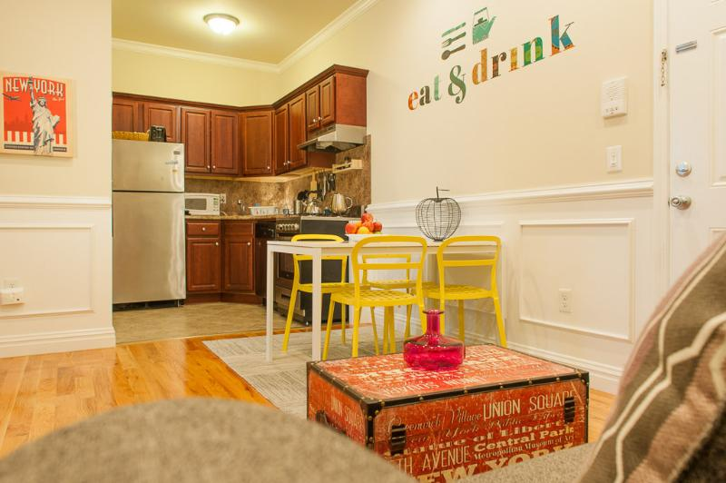 Open living room/kitchen area.   Full fridge, gas stove, micro - Big Apple Awaits!  Prvt 2 Bdrm Apt 15 min-Times Sq - Weehawken - rentals