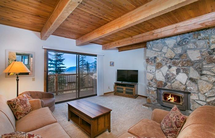 Timber Ridge #31 Living Area With A Wood Burning Fireplace And Queen Sofa Bed - Timber Ridge 31 - Mammoth Ski in Ski out Condo - Mammoth Lakes - rentals