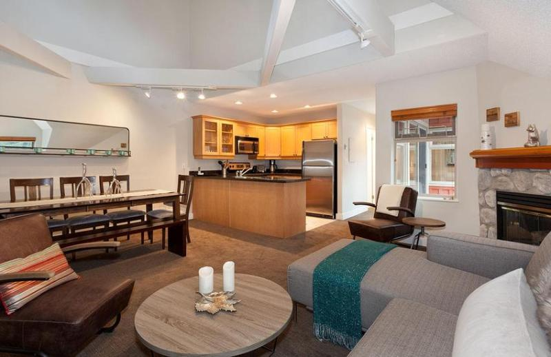 Open concept living area: includes access to private deck, gas FIREPLACE, large couch, Flat Screen TV, and cathedral ceilings - Whistler Ideal Accommodations: Beautiful 3 bedroom ski in ski out - Whistler - rentals