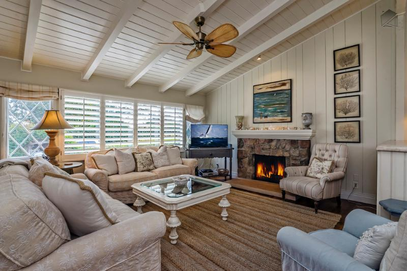 The bright, cheerful great room with skylights and hardwood floors is both stylish and functional. Watch movies on the flatscreen TV with DVD player, or relax with a book by the gas fireplace. - A charming, sunny cottage in Montecito - Rosemary Cottage - Montecito - rentals