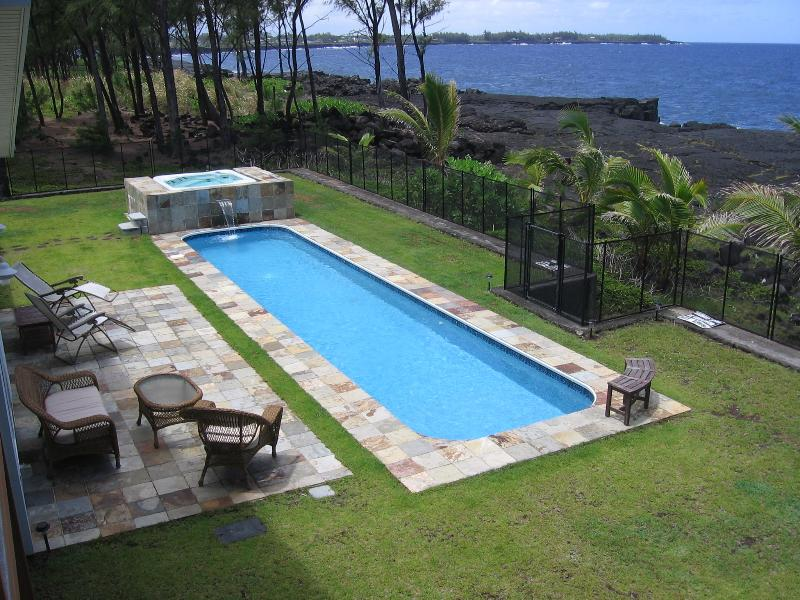 Hale Mar's spectacular 38' lap pool and hot tub by the ocean, under the stars! - Hale Mar: Luxury, Absolute Oceanfront Home w/private Pool and Hot Tub! - Keaau - rentals