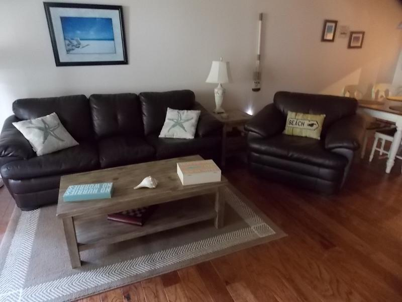 Cozy living room with leather sleeper sofa and leather chair, new wood floors throughout - Newly Remodeled Villa, Wifi, Close to Beach! - Hilton Head - rentals