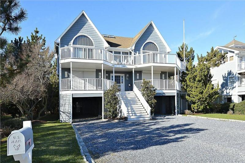 Beautiful 5 bedroom beach house with porch and hot tub! - Image 1 - Cedar Neck - rentals