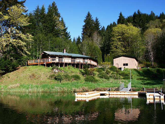 Wrap around deck overlooks gorgeous Loon Lake. Private dock - Waterfront Vacation Home on Loon Lake - Reedsport - rentals