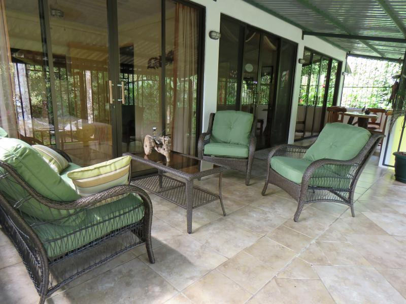 Deck view, 3 patio doors to Living room and both bedrooms - 2 Bedroom,pool, private deck, WiFi, BBQ,1000 sq/ft - Manuel Antonio National Park - rentals