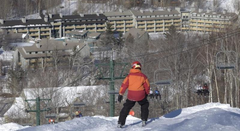 Skier looks out at Loon Village - 1 BED RM CONDO VILLAGE LOON MOUNTAIN LINCOLN NH - Lincoln - rentals