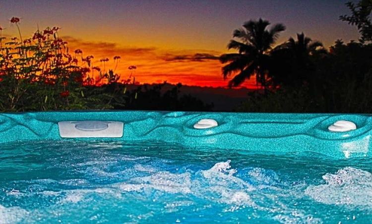 Jacuzzi at sunset - Tradewinds Honeymoon/Vacation Suite - Haiku - rentals