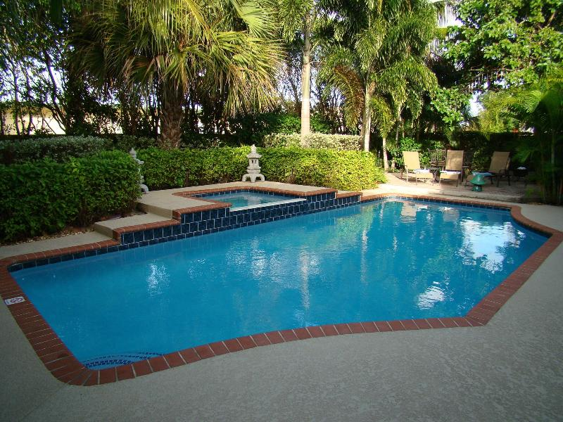 Pool in early evening. - Luxury Tropical Paradise - Heated Salt Water Pool - West Palm Beach - rentals