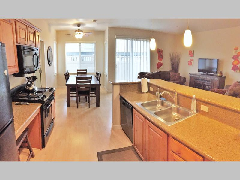 Open living areas provide perfect space for hanging out w/ coworkers or family - Downtown Luxury Condo Near Convention Center (ADA) - Salt Lake City - rentals