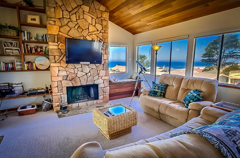Living room with ocean view, woodburning fireplace, reclining sofas, HDTV and window seat. - The Cambria Beach House - Relax, Unwind, Refresh! - Cambria - rentals
