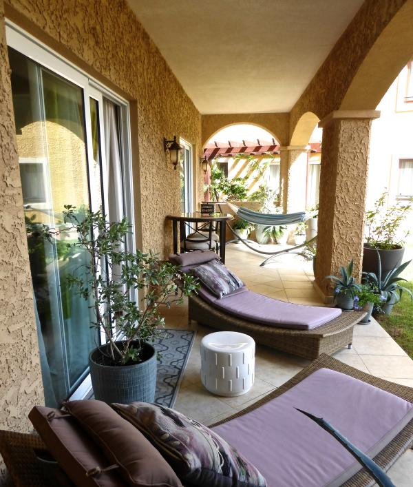 Patio area onlooking garden and lagoon style pool - Tranquil Settings, Porto Cupecoy (1 or 2 br opt) - Cupecoy Bay - rentals