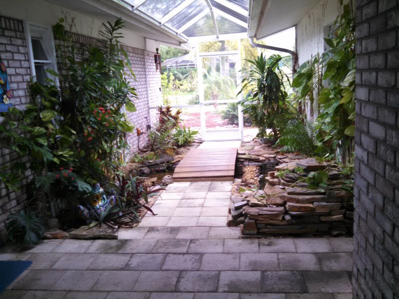 Lanai entrance with foot bridge, fish pond & waterfall - Tropical Waterfront Pool Villa with Guest House - Cape Coral - rentals