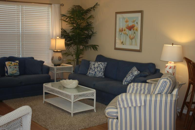 Main living area - wood laminate or tile throughout - Sunset Beach, NC 1st Floor Condo 2BR 2Bath Pets - Sunset Beach - rentals