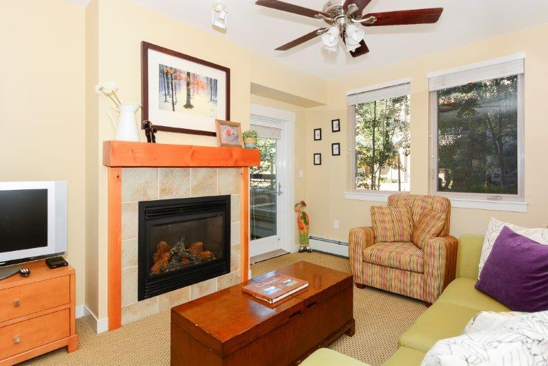 Fireplace and patio access from living room - Fraser Crossing 3319 - Winter Park - rentals