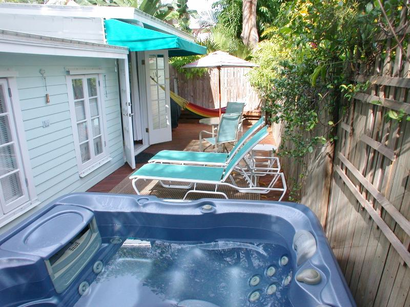 Sundance spa on private back deck with lounge chairs, hammock, dining table, BBQ - Key West Seashell Cottage-1 block to Duval, spa - Key West - rentals