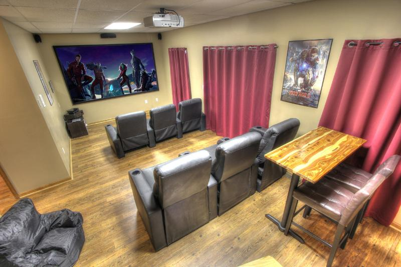 Theater room has 120 inch screen, surround sound, recliner chairs and a small bar. - Sasquatch Ridge - NO FIRE DAMAGE - Perfect Location, Walk To Pool, Theater - Pigeon Forge - rentals