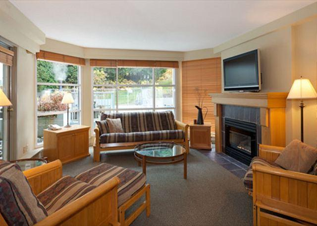 Bright Living Room with Gas Fireplace and Mountain Views - Woodrun Lodge 204 | 2 Bedroom Ski-In/Ski-Out Condo, Fireplace, Shared Hot Tub - Whistler - rentals
