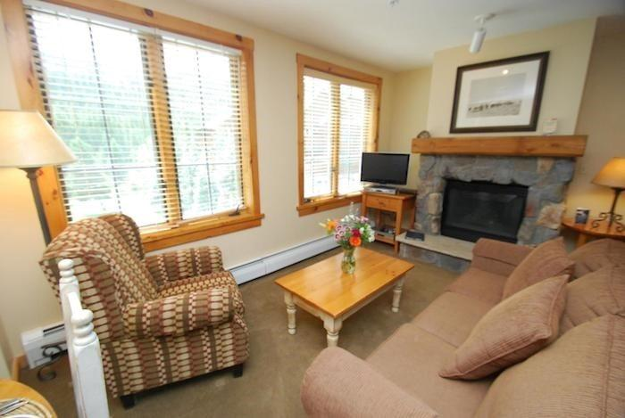 Relaxing living room with a stone fireplace - Dakota Lodge 8484 - Ski area views, King and Queen beds! - Keystone - rentals