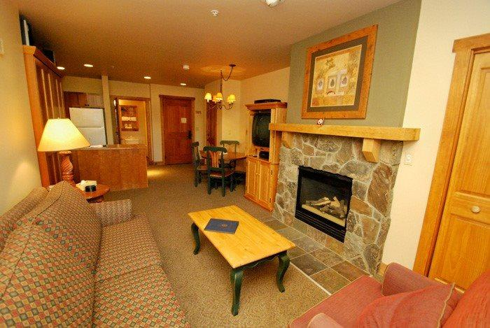 Cozy living room with a stone fireplace  - Red Hawk Lodge 2200 - Cozy studio, walk to slopes, on site pool, hot tub, fitness room and pool table! - Keystone - rentals