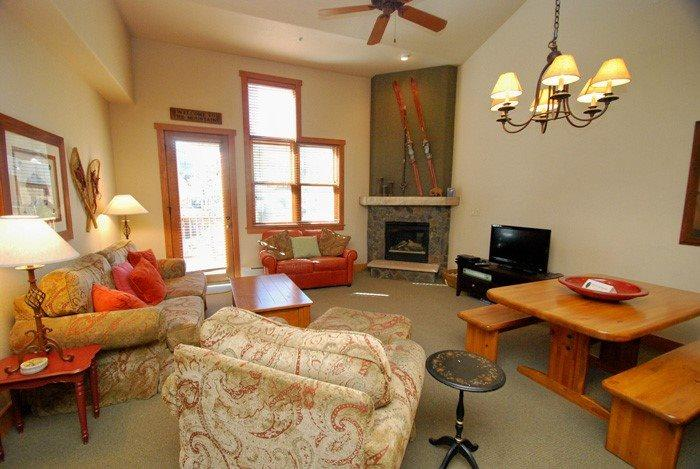 Colorado mountain themed living room with a stone fireplace and a game table  - Red Hawk Townhome 2337 - Spacious, three level property with washer/dryer, walk to slopes! - Keystone - rentals