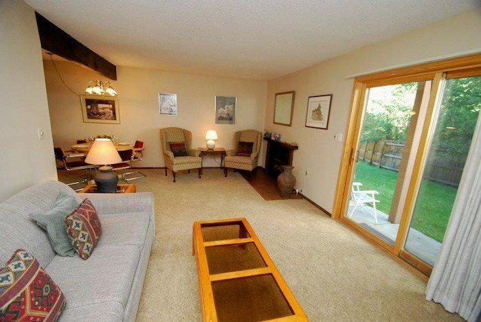 Spacious living room with a pull-out sleeper sofa  - Snowdance Condominiums A104 - Walk to slopes, ground floor, Mountain House! - Keystone - rentals