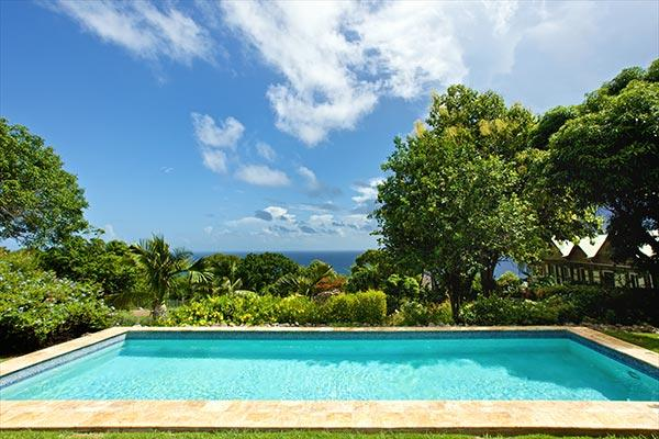 Nestled in the Butlers Mountain foothills, this Nevisian- style villa commands sweeping sea views. KL BUT - Image 1 - Saint Kitts and Nevis - rentals