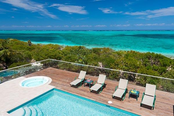 Nestled amid lush, tropical landscaping, this villa fronts miles of white sandy beach. TNC DAW - Image 1 - Grace Bay - rentals