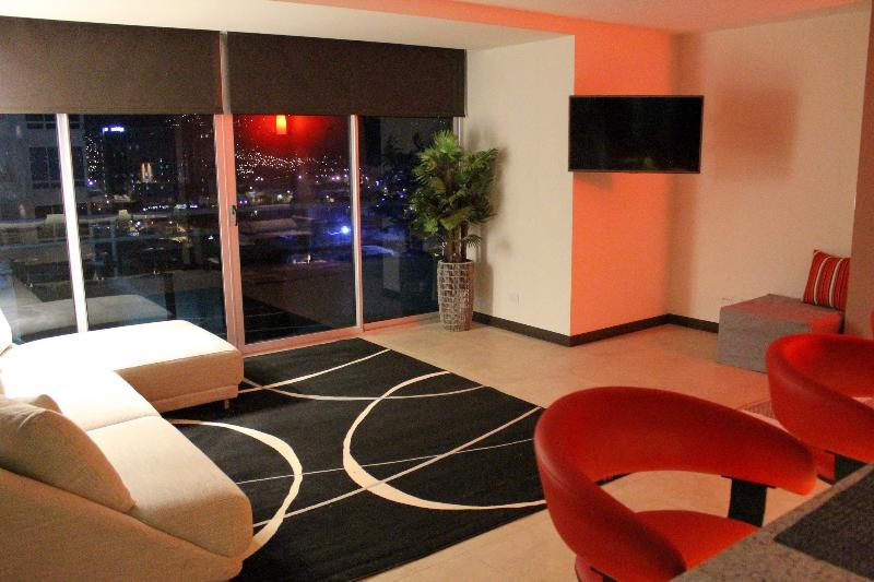 Oasis living area is chiq & modern. The city views towards Escazu are splendid. - Magnificent Oasis Premium w/ AC & Airport Shuttle - San Jose - rentals