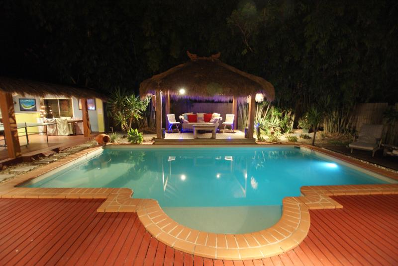 the Oasis Private Heated Pool night lit for enjoyment - Burleigh Beach Oasis | OUTDOOR ENTERTAINING | LARGE POOL | by Getastay - Burleigh Heads - rentals