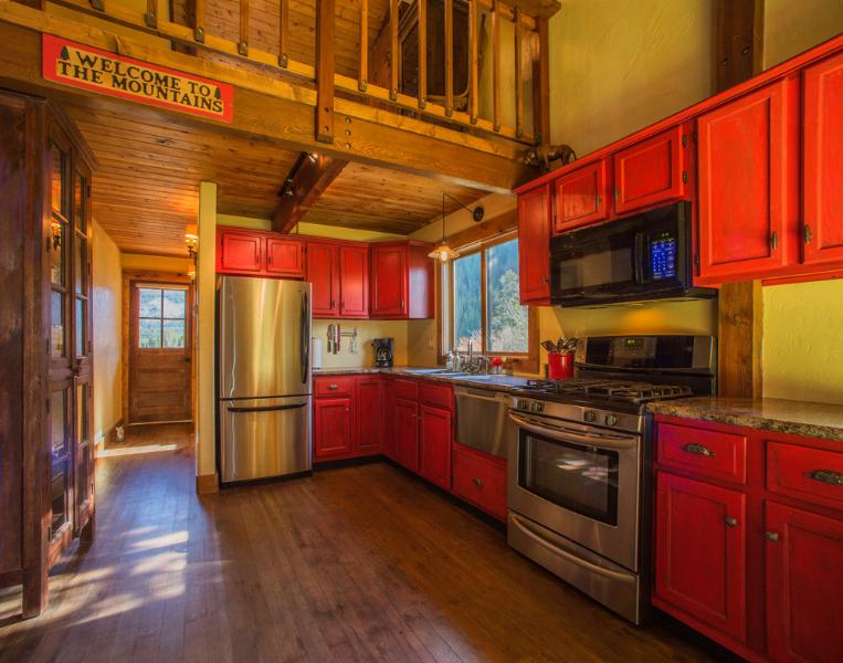 The Powder Pad's kitchen, featuring stainless steel appliances - Charming Boutique Cabin in a Private Setting! - Breckenridge - rentals