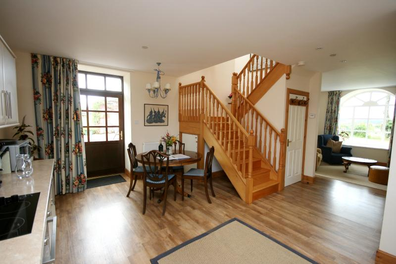 Open plan Dining /Living room with stairs to bedrooms - Oak at Finnich Cottages - Loch Lomond and The Trossachs National Park - rentals