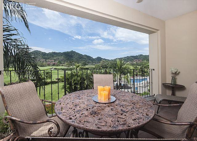 Balcony with pool and golf course view. - Green Paradise Condo with Golf course view at Los Sueños! - Herradura - rentals