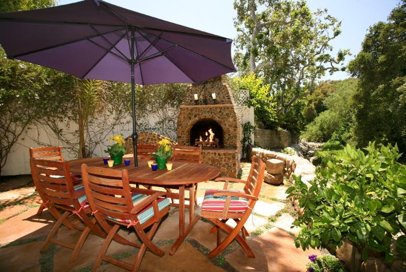 Creekside patio and outdoor fireplace - Seaside Cottage - Montecito - rentals