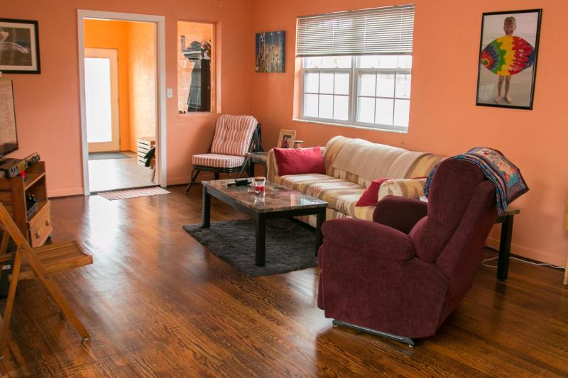 Hardwood Floors in the Living Room and throughout the Bedrooms - Fall $pecials- Vacation  Home #607 Garden View - Daytona Beach - rentals